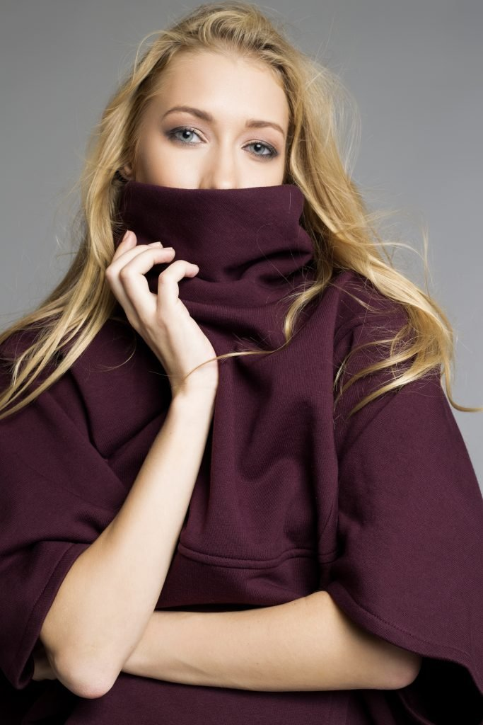 women wearing a maroon organic cotton poncho