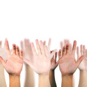 hand raised up for volunteering